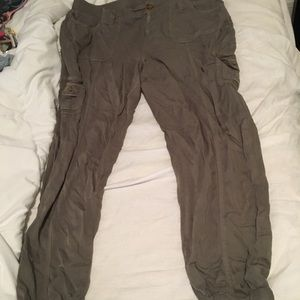 Olive green cargo pants with cinched ankles